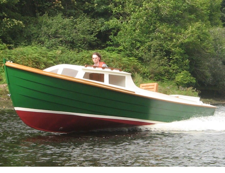 Classic 22' wooden power boat at speed, custom built in Cork Ireland by Roeboats