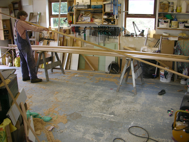 Checking wood for 16 foot sharpie sailboat custom built by Roeboats, Co. Cork
