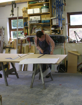 Marking out the frame material for a 16 foot sharpie sailboat custom built by Roeboats Co.Cork Ireland