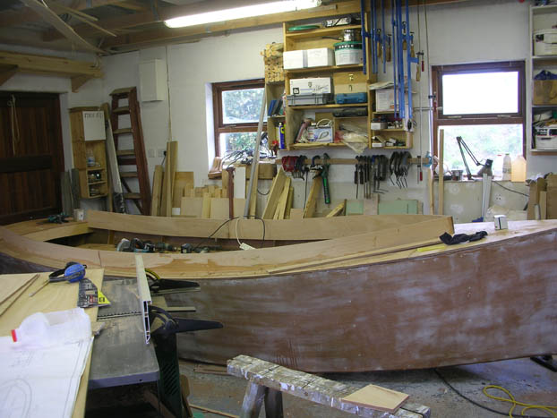 Finishing coaming on catbird 16 foot wooden sharpie dayboat lugsail built by Roeboats West Cork Ireland for sale