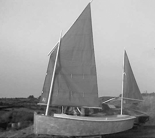 Catbird sharpie yawl test rigged with sails
