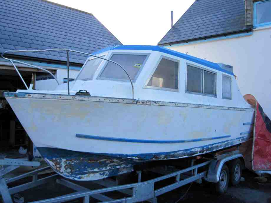 cabin cruiser sanded down and ready for paint.