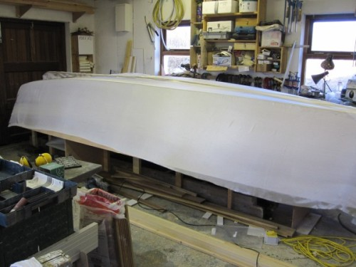 Glass fibre draped over sharpie microcruiser prior to epoxying